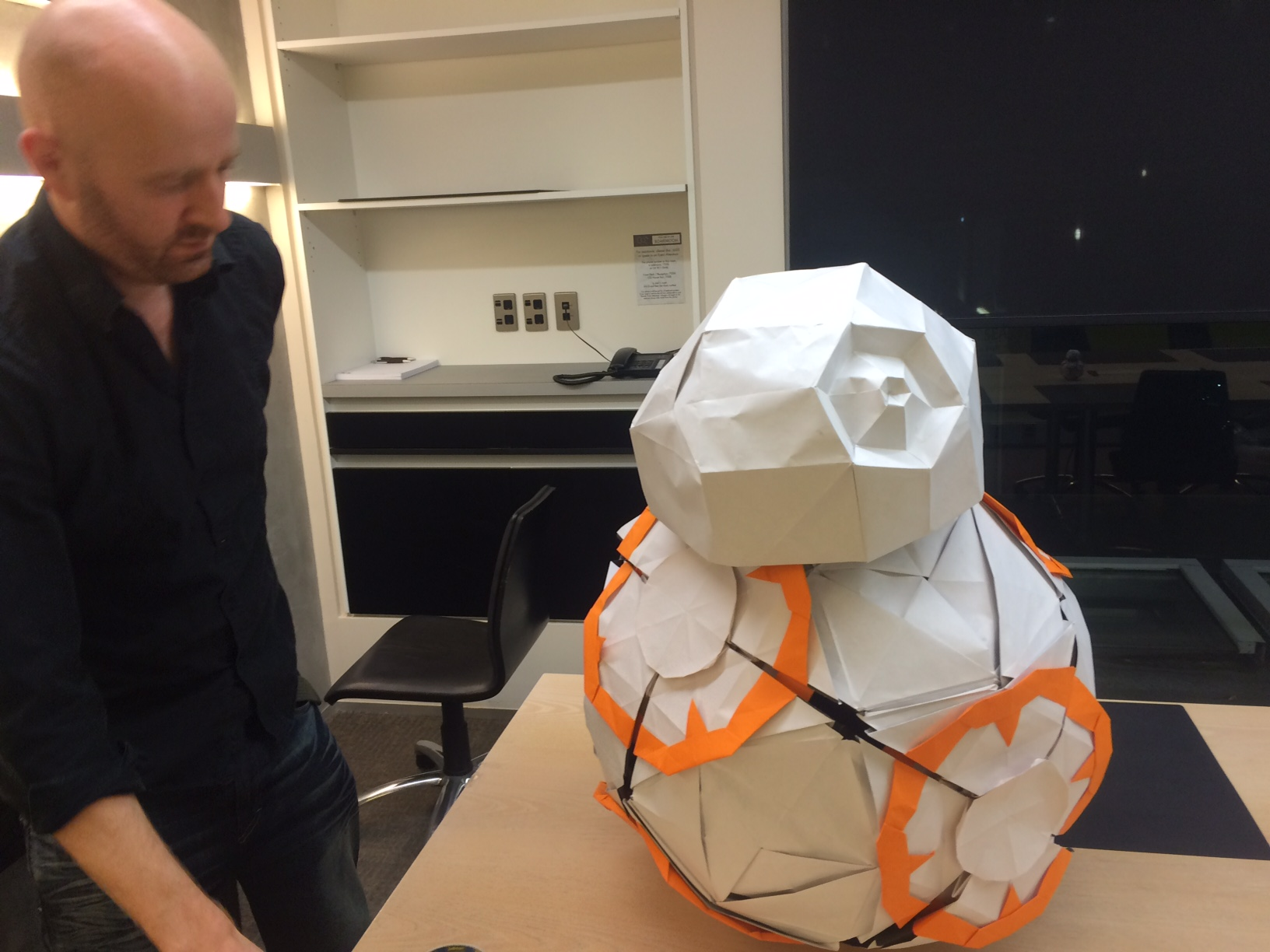 Star Wars Origami guru Martin Hunt puts the finishing touches on BB8